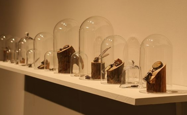 Curio glass cloches containing object jewelry are a simple yet original way to display merchandise.