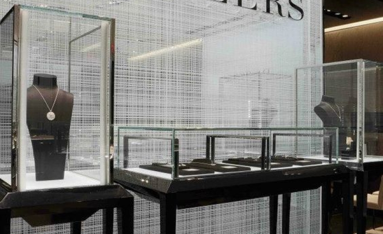 De Beers Diamond Jewellers glass display of luxurious pieces in the Vancouver store.