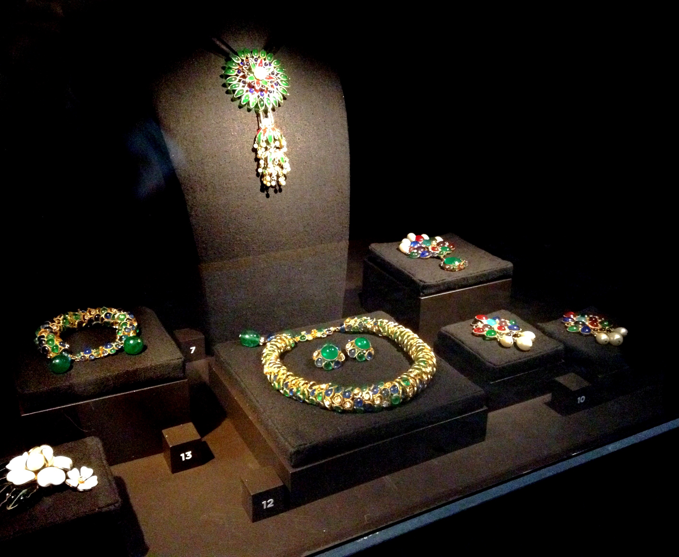 Gorgeous colored neck pieces, bracelets and earrings displayed at a Chanel exhibition.