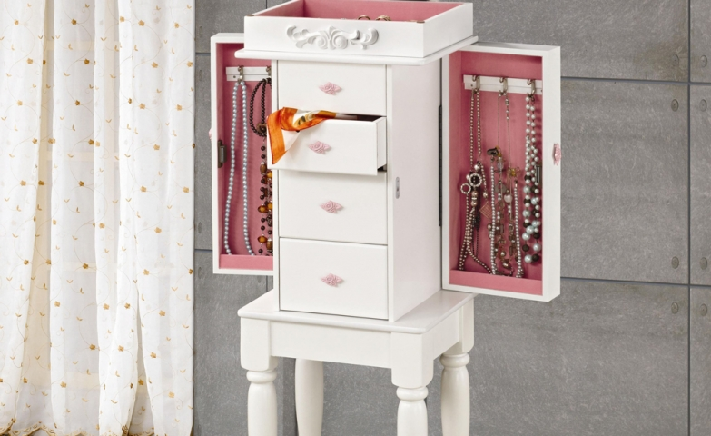 White jewelry armoire with pink hardware, interior mirror and lots of storage room.