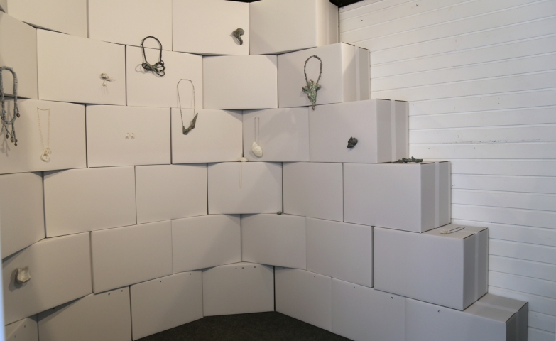 Check out this contemporary jewellery exhibition, a simple yet creative display made of all white boxes.