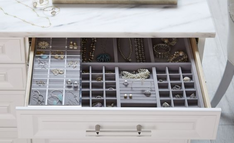 Drawers can be customized and used for jewelry storage as seen in this image.