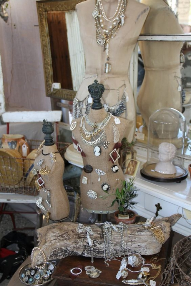 Dress forms used as props to display jewelry, among other unusual props.