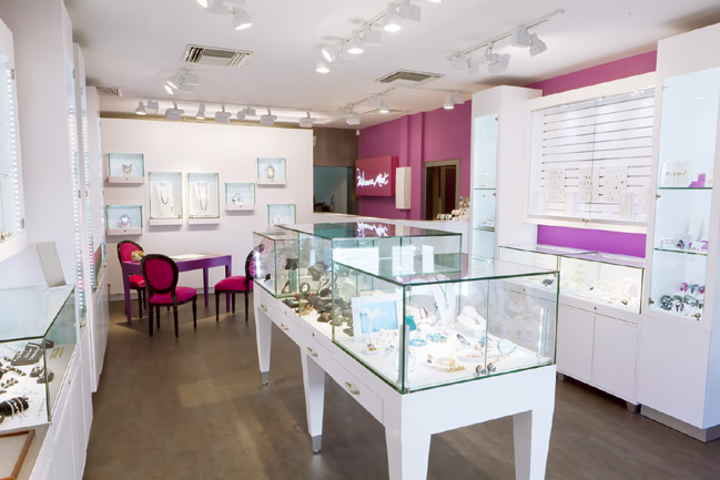 White furniture is quite popular, and if you want some pop to it just add an exiting color like pink - Fabienne Miot store.
