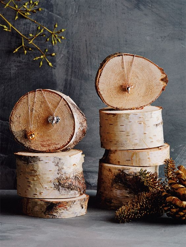 A flashback to 2014, Anthropologie EU. A uniquely enchanted Christmas inspiration display using different sized tree trunks.