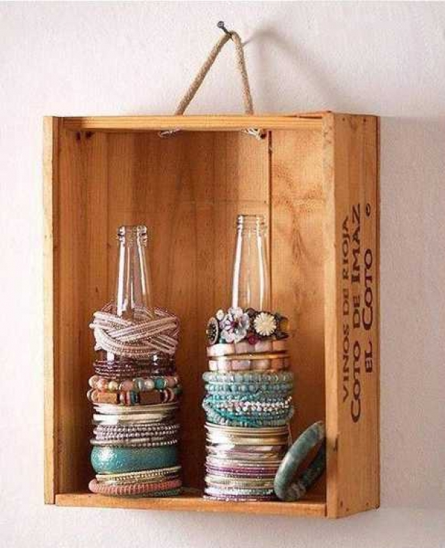DIY jewelry organizer storage ideas made from a wine box hanged on the wall and glass bottles used for holding bracelets.