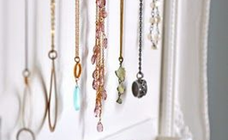 Close-up on an idea for DIY jewelry storage, for hanging necklaces and keeping rings and small earrings.