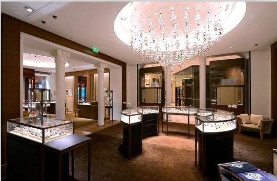 Jewelry store interior design created with led lights and stainless steel legs. Although modest, it has a lot of elegance.