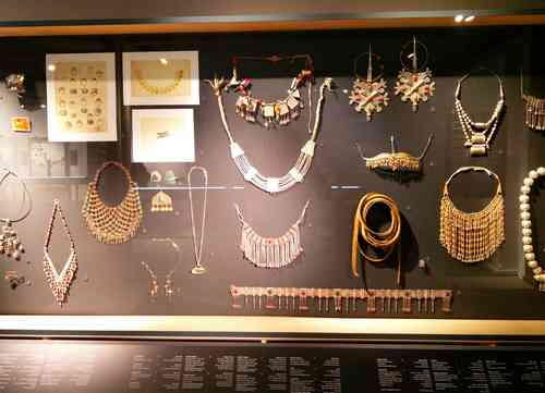 Eretz Israel Museum jewelry display exhibition with many traditional jewels, mostly necklaces and neck ornaments.