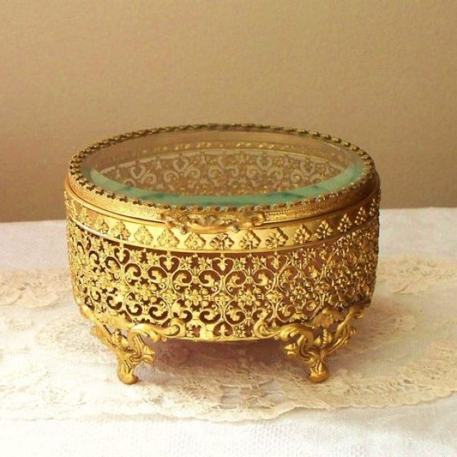 Lovely elegant glass and ornate gold jewelry casket for the most precious pieces.