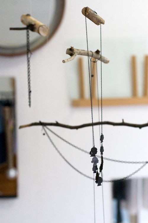 Tree elements used for jewelry display, what a great idea to give a natural vibe to a setting.