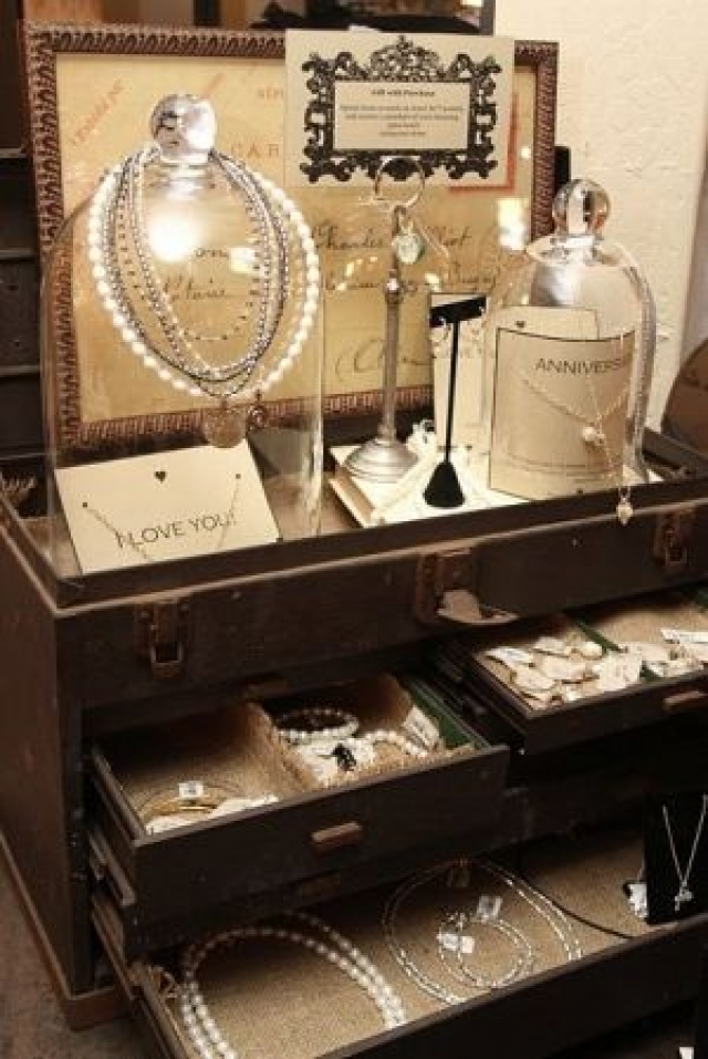 Vintage look and setting with drawers, frame and glass hangers to create a retro jewelry display.