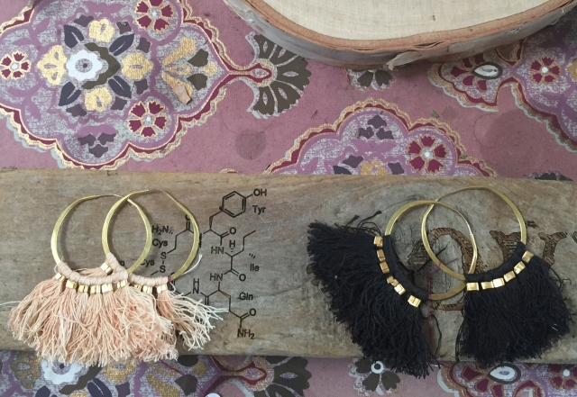 Vintage mixed with chemistry for jewelry visual merchandising will attract curious eyes.