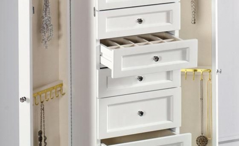 Beautiful Hampton Bay jewelry armoire, in white finish with drawers, vertical hangers and a small interior mirror.