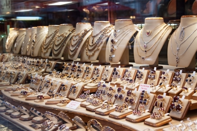 Setting for jewelry displays which help balance visibility and protection, an idea for an abundant visual merchandising display.