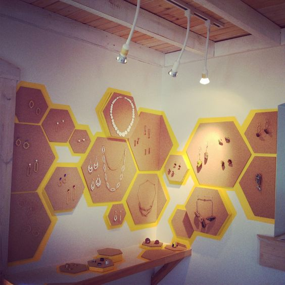 Heidi Lowe Gallery inspires so many creative exhibitions. This exhibit went for the hexagonal theme, combining brown and bright yellow. Jewelry always placed right on the display piece with no cover.