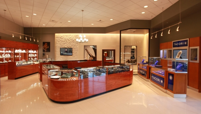 Bright lights combined with massive wood pieces in this jewelry store from Dublin, CA.