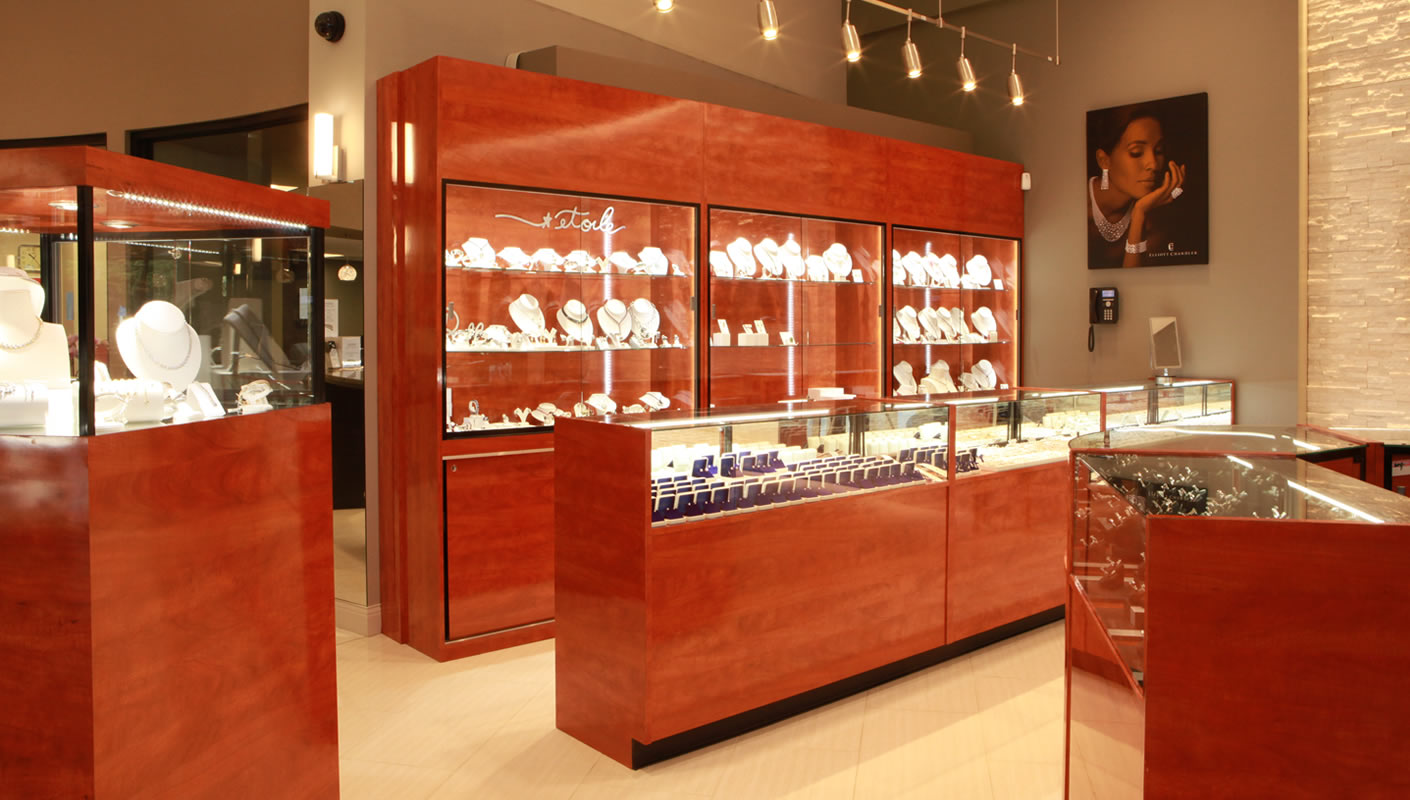 Classic design with massive wood furniture displays from a jewelry store in Pleasanton, CA.