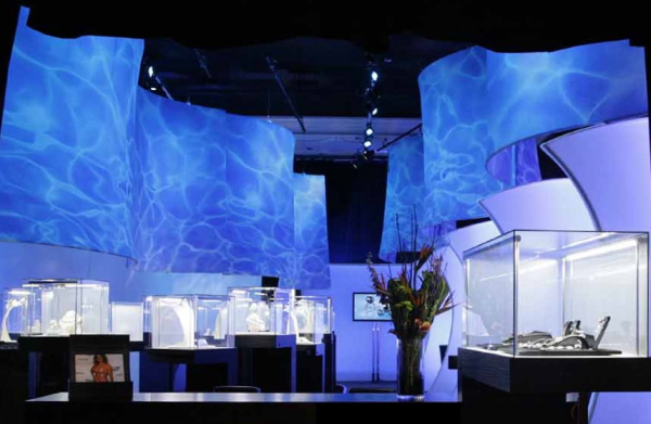 This jewelry exhibit has a design inspired by the shades of water, emerging the viewers into the glass box displays where the pieces are presented.