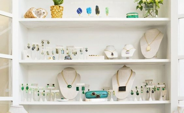 Fantastic display by Margaret Elizabeth Jewelry Studio Tour. Although simple, a few unusual decoration pieces like a golden elephant a few cute plants give it a nice touch.