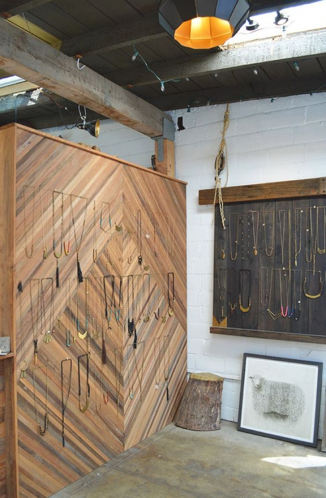 Necklaces hanged and displayed directly on the wall inside the Marisa Haskell jewelry shop and studio in Temescal Alley, Oakland.