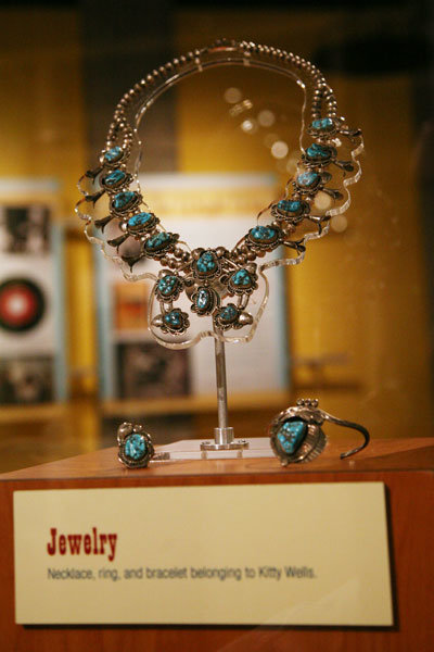 Necklace, bracelet and ring set with blue gem stones from the Kitty Wells Exhibit.
