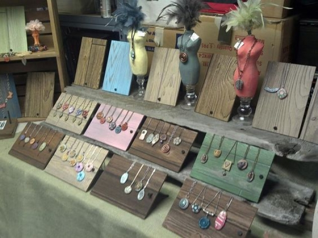 Natural and painted wooden boards are a great prop to use for merchandise jewelry display.