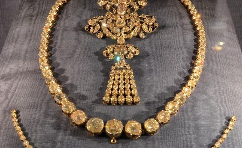 Vintage elegant pieces displayed at the Louvre Museum as part of the Royal Jewelry exhibition.