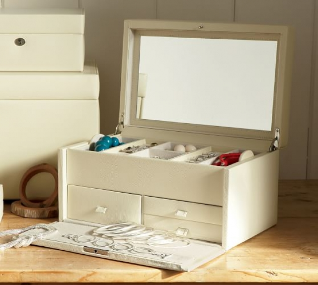The McKenna jewelry box is dressed in leather and comes with drawers, storage boxes and a large interior mirror.