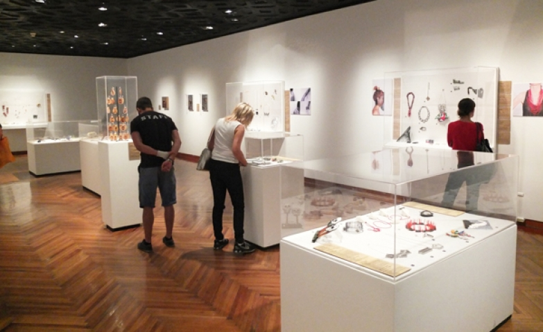 La Frontera reception and jewelry exhibition shows various glass displays with curious jewelry pieces inside them.