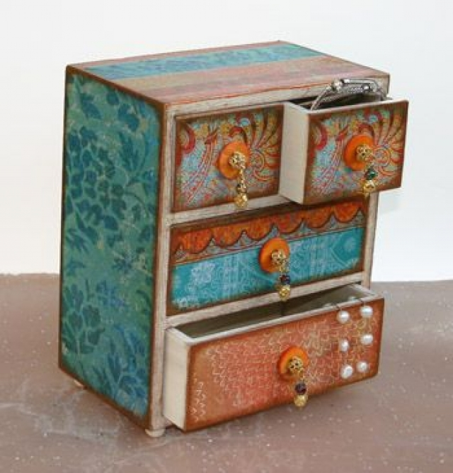 Lovely little Moroccan Bazaar jewelry box with small drawers and a colorful exterior finish.