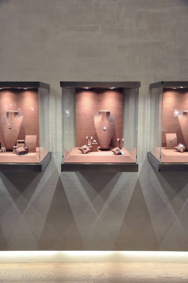 The lights from the glass box display create a nice effect underneath them, design for The Rosa Jewellery by Puntidifuga, Mondovi, Italy.