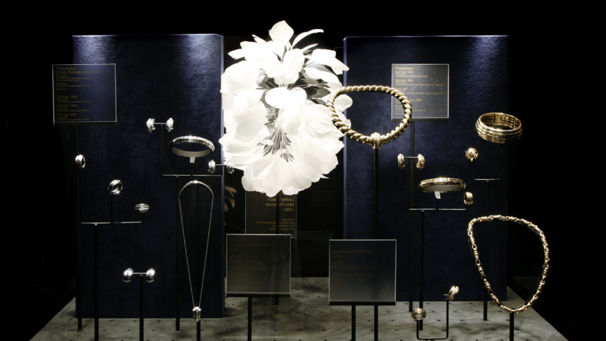 White and dark blue setting for pieces as part of a Piaget Manufacture exhibition.