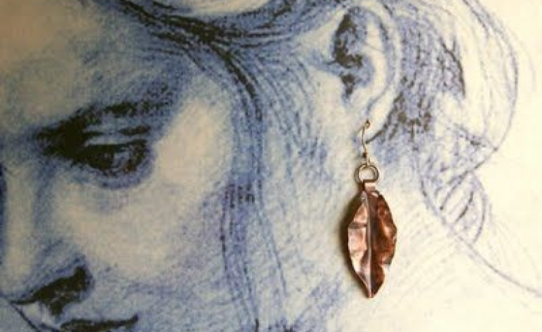 Such a subtle way to display merchandise by using a sketch to display earrings.