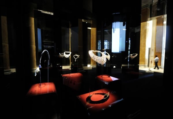 Floating delicate neck pieces on glass stands seen at the retrospective exhibition from Bulgari.