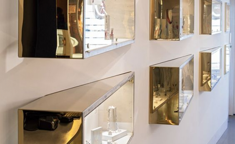 Very unusual rectangular glass displays with mirror gold exterior finish, seen at Sarah May Jewellery.