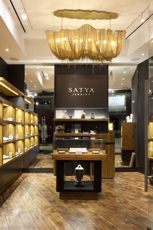 Gold props combined with wood elements for the decor of the Satya jewelry store designed by Anjie Cho.
