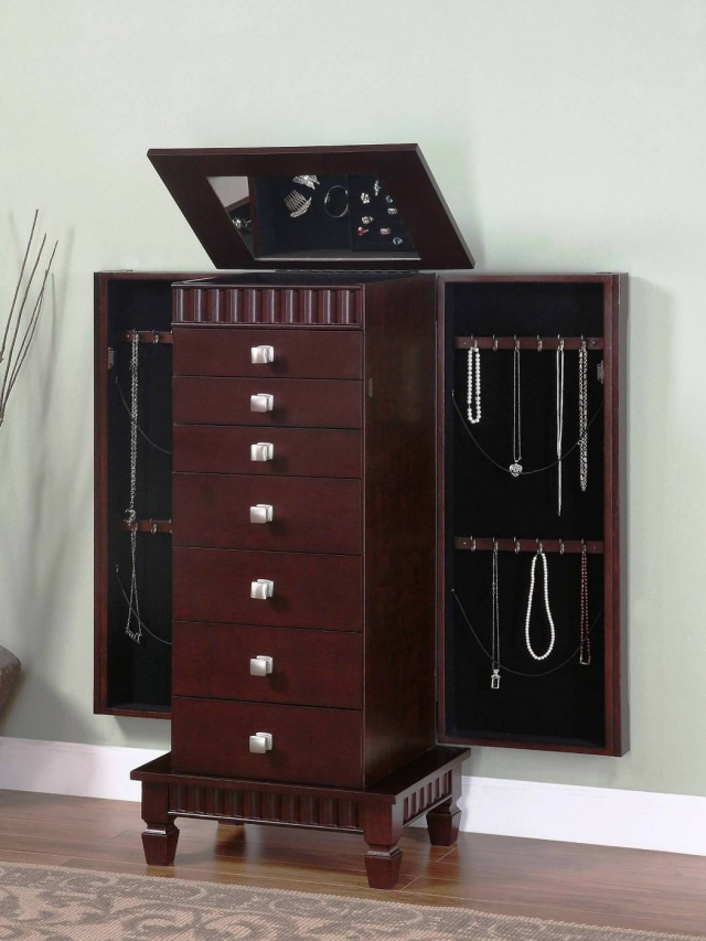 Powell jewelry armoire, in dark brown with many drawers, vertical hangers and an interior mirror.