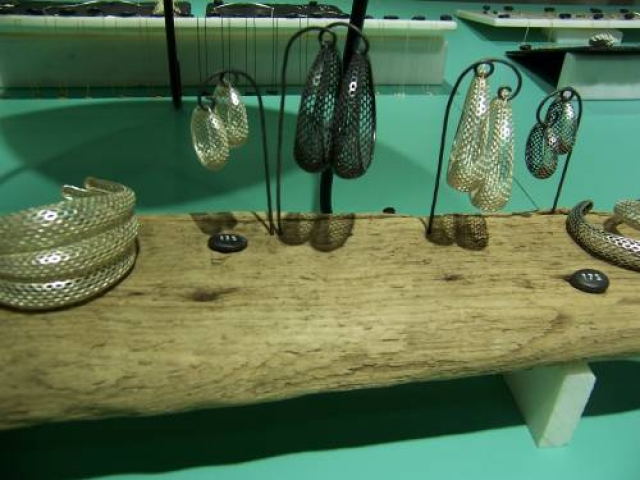 Using natural materials for a display creates a natural simplistic setting for both visual merchandising and store display.