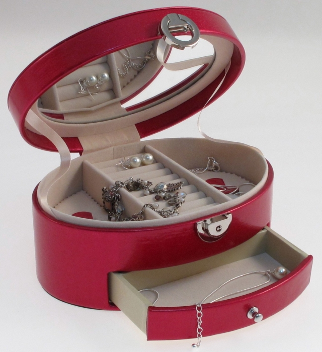 Red round shaped jewellery box with a drawer and storage for rings.