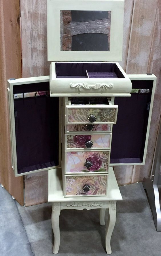 Repurposed jewelry armoire, custom made with a vintage look and colorful drawers.