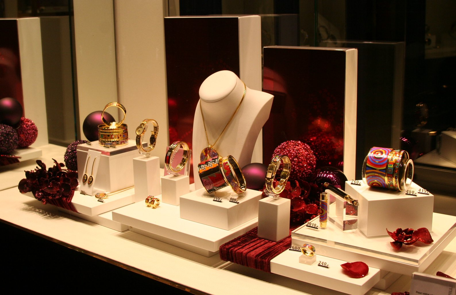 Festive visual merchandising display with red elements and decoration.