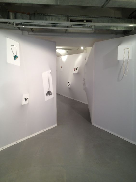 Corridors with jewelry pieces placed on them from The Lunatic Swing, which was an exhibition at the Schmuck Fair (2013).