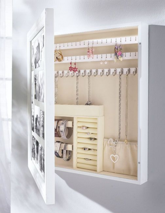 Turn a picture frame in a jewelry solution just like this one, simple and clever.