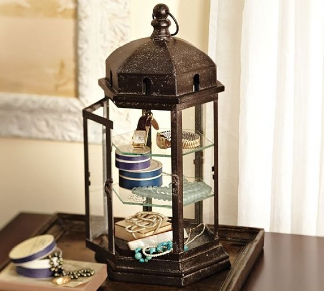 Use an old lantern in your store to display jewelry in a unique way, and at the same time adding to the room decor.
