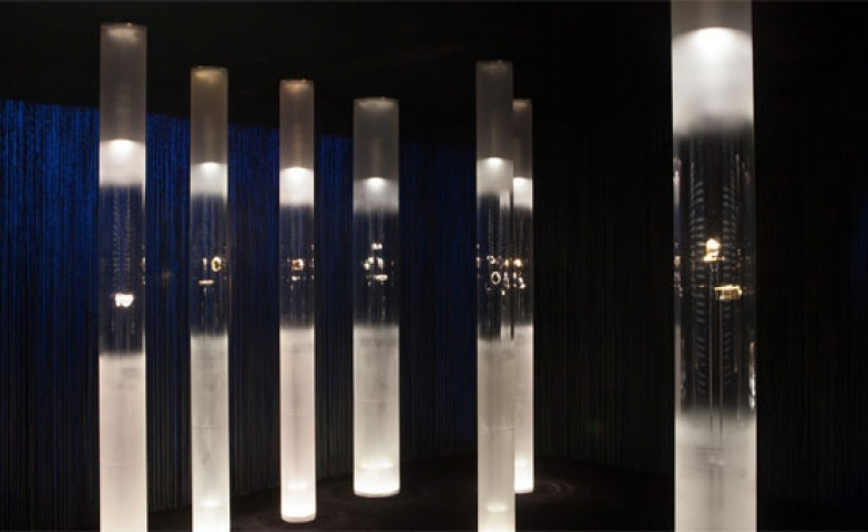 Another stunning display design for Van Cleef & Arpels exhibition, jewelry pieces put on display in tall cylindrical glass tubes.