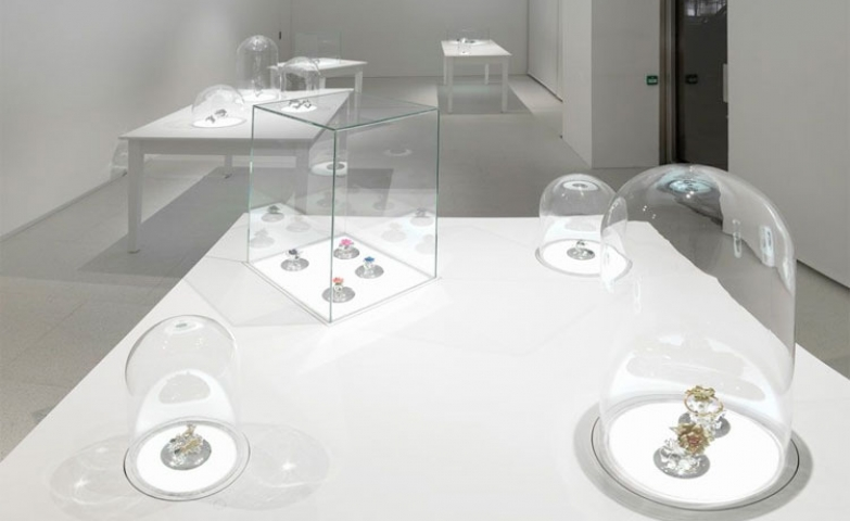 "All white exhibition room, very bright and glass bubbles and cubes used to display the jewelry pieces for Victoire de Castellane's first New York exhibition ""Jewelry with lineage"""