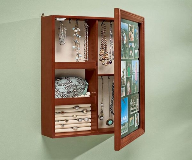 Wall mounted jewelry armoire with plenty of storage solutions, and great to keep your jewelry discretely.