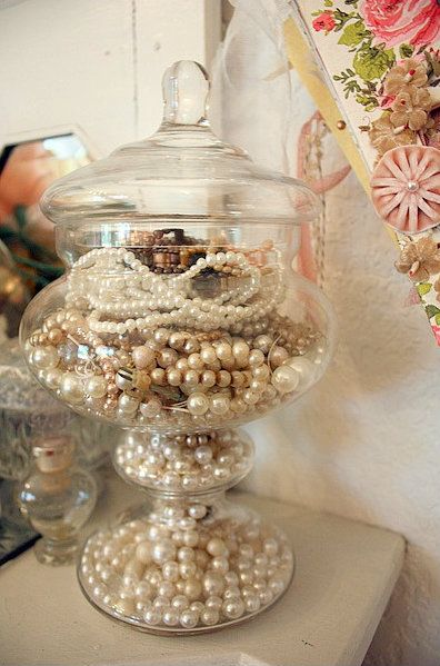 A jar can be used to keep pearls, it has a great elegant look to it and a vintage vibe.