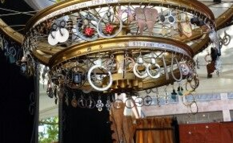 Taking creativity to a whole new level with this bicycle wheel rim used as tiered jewelry display chandelier.